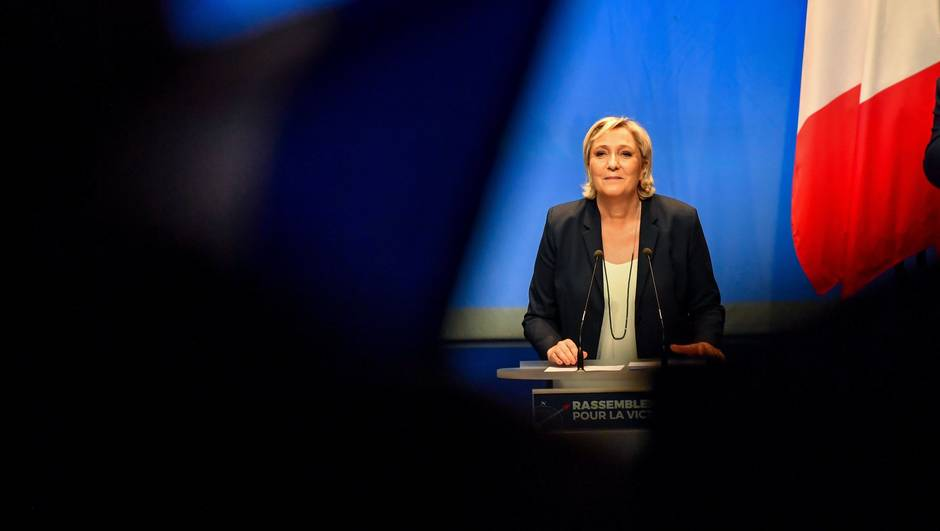 French far-right party Front National president Marine Le Pen speaks during her party's congress on March 11, 2018 in Lille, north of France, after being re-elected for a third term as leader. The 49-year-old proposed changing the party's name to the National Union as part of efforts to improve its image which has been associated with her father Jean-Marie since 1972.  / AFP / PHILIPPE HUGUEN